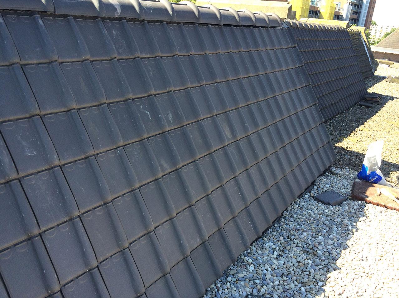 Pannenkap vervangen en een plat bitumen dak vervangen